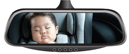 Rearview mirror showing child in carseat
