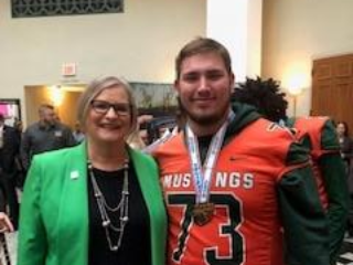 Chairman Lori Hershey and Mandarin High School Mustang