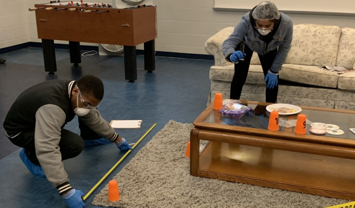 Students in the Criminal Justice Career Academy analyze a mock crime scene