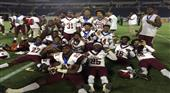 Raines Vikings display their championship medals