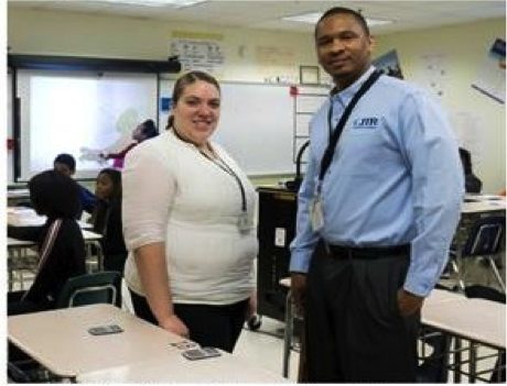 Cohort 1's Kylee (left) with her CRM Mr. Baldwin in their mathematics class at Northwestern Middle School, 2014